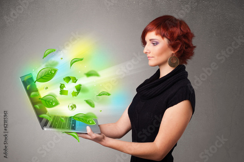 Casual woman holding notebook with recycle and environmental sym