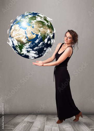 Pretty girl holding 3d planet earth