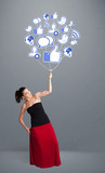 Pretty woman holding social icon balloon