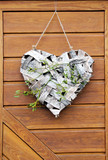 Heart deco made of tree bark with mistletoe branch on door