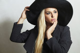 Beautiful Blond Woman in Hat. Fashionable Lady.Spring Collection
