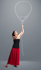 Beautiful woman holding balloon drawing