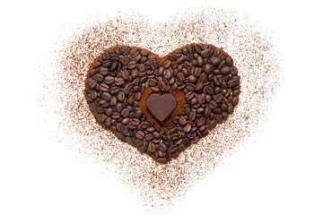 Heart made of ground coffee,coffee beans and chocolate heart