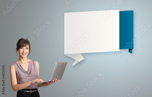 attractive woman holding a laptop and presenting modern origami
