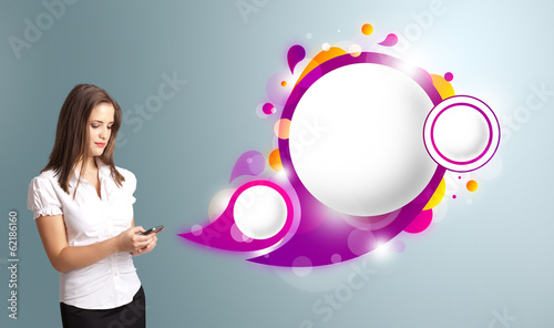 Pretty woman holding a phone and presenting abstract speech bubb