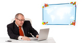 businessman sitting at desk and looking the laptop with copy spa