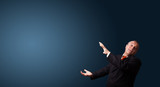 funny businessman gesturing with copy space