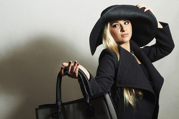 Beautiful Blond Woman in Hat and Topcoat.Handbag.Spring Shopping