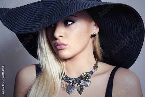 Beautiful Blond Woman in Black Hat.Beauty Girl. Spring Jewelry