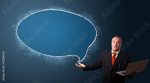 funny businessman holding a laptop and presenting speech bubble