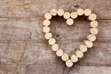 Wine corks form a heart shape on the wood board