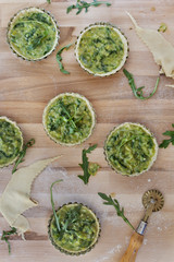 homemade vegetarian tartellettes with leeks and rocket