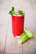 tomato juice in glass and green celery