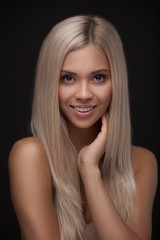 Young smiling woman with beautiful healthy face