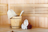 Traditional wooden sauna for relaxation with bucket of water and