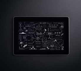 A tablet pc over the black background