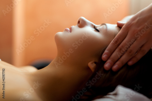Woman receiving a head massage