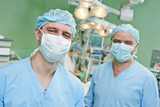 smiling surgeons team at cardiac surgery operation