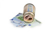 Roll of euro banknotes in a money jar against white background