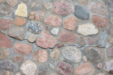Rock wall made of stones and cement.