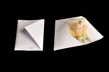 Euro bills in white envelope isolated on black background