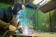 Welder worker during welding works