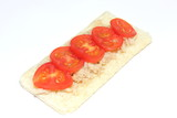 Tuna and tomato crispbread on a white background