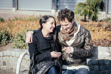 Young Couple Using Mobile Phone