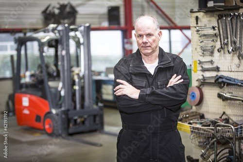 mechanic in forklift garage