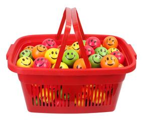 Red shopping basket full of smiley balls
