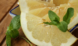 Slice of Pomelo and sprig of mint