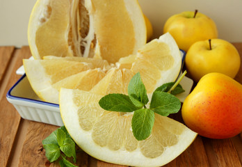 Slice of Pomelo, a sprig of mint and apples