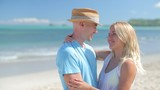 Caucasian couple on tropical beach happy smile
