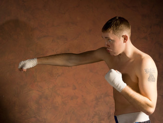 Young boxer in training throwing a punch