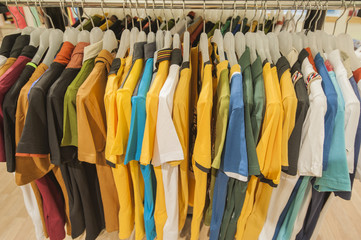 Row of tshirts hanging on a rail