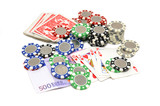 Royal flush poker hand with poker chips and euro bills isolated