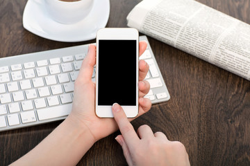 businesswoman hands holding a phone with isolated screen in the