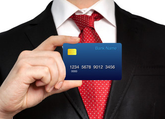 businessman in a suit holding a credit card