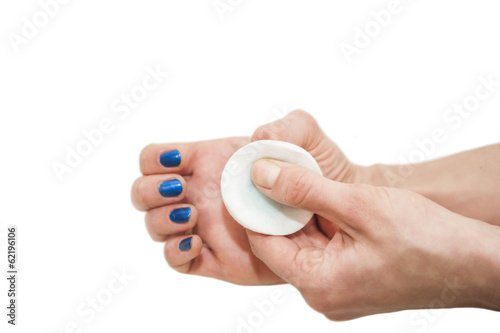manicure process: removing nail polish with nail-polish remover