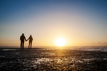 Romantic photo of couple during sunset
