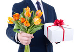 gift box and tulip flowers in male hands isolated on white