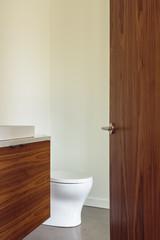 Luxury Bathroom with Open Wooden door