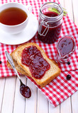 Delicious toast with jam on table close-up