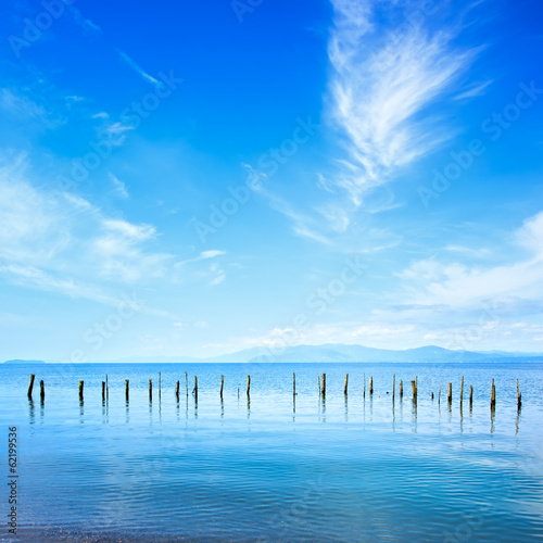 Poles and water on ocean landscape. Long exposure.