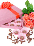 Delicious chocolates in box with flowers close-up