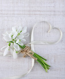 Bouquet of beautiful snowdrops on wooden background