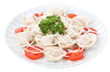 Meat dumplings - russian boiled pelmeni in plate isolated
