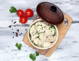 Meat dumplings - russian boiled pelmeni on wooden table
