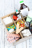 Medical pills,stethoscope,  ampules in wooden box,