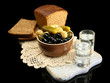 Composition with glasses  of vodka, and marinated  vegetables,